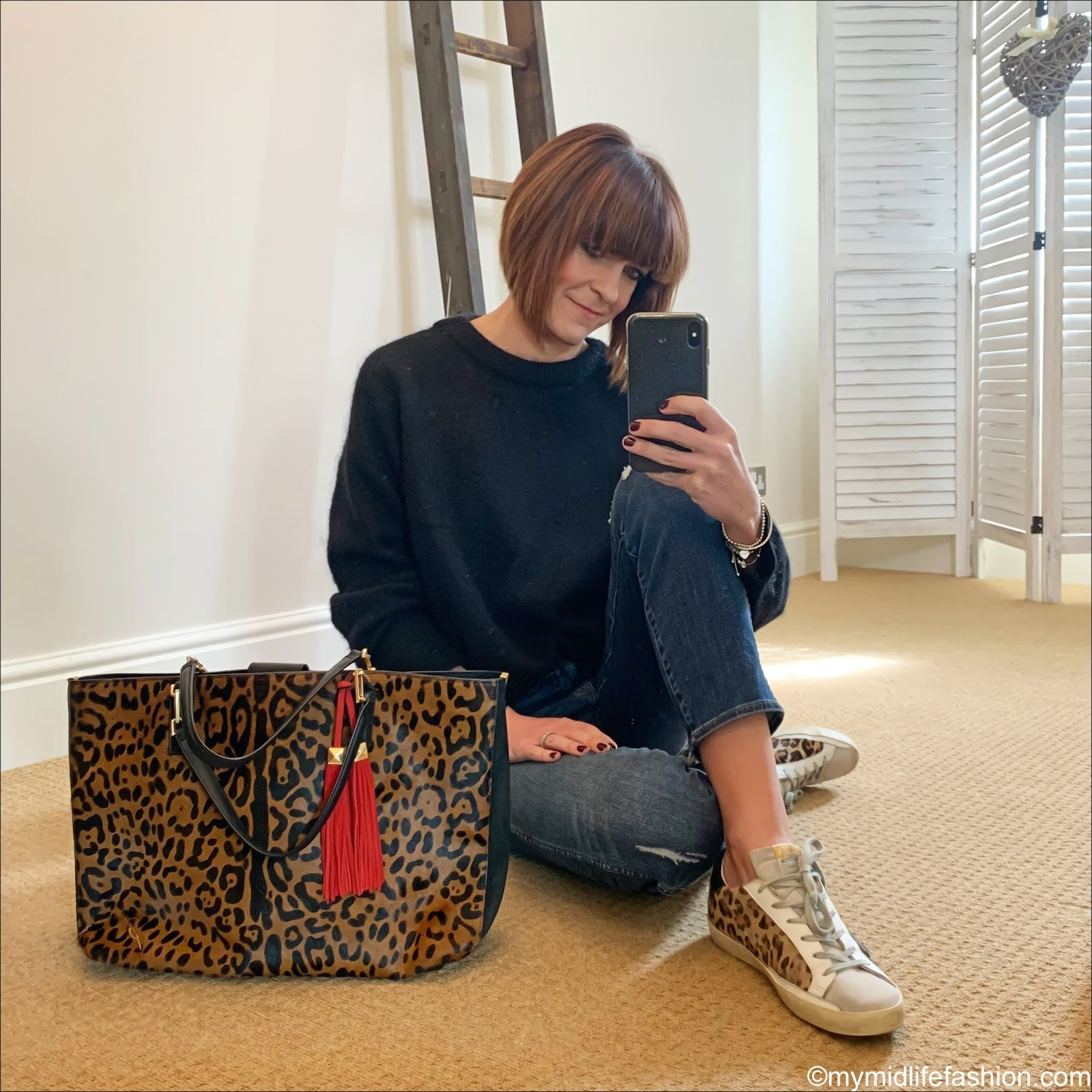 my midlife fashion, acne studios dramatic crew neck jumper, brian atwood leopard print leather tote, j crew straight leg rip and repair jeans, golden goose superstar low top calf hair leopard print trainers