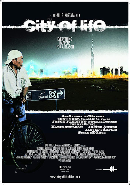 City of Life (2009) is an Emirati (UAE) realistic film directed by Ali. F. Mostafa in 2009. It is a realistic film because it has real people with real problems. It has negatives and positives both. But negative is a little. The film is produced by Leigh Clarke, Ali. F. Mostafa, Tim Smythe and Tanya Wagner.  The film is starred by Alexandra Maria a Romanian-German actress as Natalia Moldovan, Jason Glemyng an English actor as Guy Berger, Sonu Sood an Indian actor as Basu/Peter Patel, Natalie Dorman a British actress as Olga, Saoud Al Kaabi an Emirati actor as Faisal, Yassin Alsalman (Narcy) an Emirati actor (well as Iraqi-Canadian journalist) as Khalfan, Javed Jaffrey an Indian actor as Suresh Khan and some other Emirati actors. The background music is composed by Matthew Faddy and barry Kirsch. The cinematographer of the film is Michael Brierley. The film is edited by Raul Skopecz. The film is released on 11 December, 2009 in Dubai. It is a multilingual film and has Arabic, English and Hindi language.    Review:  Ali F. Mostafa is a British-Emirati filmmaker. It is his first Emirati feature film. His second film's name is Worthy(2017).  I never watched an Emirati film. City of Life (2009) is the first film I have watched ever. Very film and contents and director's filmmaking style are totally different from others. Ali F. Mostafa is the lively example. At first, I have started watching the film; the beginning. Specially, the background music attracted me extremely. I thought the music is good hearable. It has a power to describe the real problems and emotions. I thought it the title background music of the film. The film is filled with real problems and real problems. Every society faces with different problems. So, Dubai the cosmopolitan city in United Arab Emirates is not different from it. The film narrates three kinds of different lives' living taking different careers and unexpected tragedy and loss lead to hope and profound transformation. In Dubai, many ethnic and man of different class work for living and family. In this film, Emirates, English and Indians are shown alike. There are some negatives and positives positions in the film these are belittling the city, many criticize that. But director has stated that in New York or London, there are some negative problems in the societies. There are negative and positive both problems in Dubai. He just upholds the real problems. But Dubai is a liberal or cosmopolitan city. And the ending part of the film is the perfect example.    Acting:  Acting of the performers is natural. So, it is a kind of non-fiction film. As the casting is realistic and the social problems are realistic and the directed has wanted to show the problems of the society in a realistic way, So, I would say it is a realistic film. There are some action scenes but they are also based on naturalism. It is an excellent casting.    Background Music:  At the beginning part of the film the background music is just extra ordinary. It is attractive to hear and it seems it is a kind of cultural music that is connected with the life of different kinds of working people in the WUE. An excellent background music I have heard ever.    Emotion:  Director has played with the spectators in the film by emotion so that the audiences can receive it with their mind. So, it will attract them emotionally. Actually the emotional scenes or the scenes of hard times of the working people have attracted the audiences mostly. It has three different geographical working people; Emirati, English and Indian. The director has shown the mind and professions differently. But he has upheld the English and Emirati characters' scene something negative and Indians' totally positively. I hope the audiences will capture it intellectually.    Technical support:   I think the cinematography and editing are also an important job in this film. I won't give more importance about color. But lighting is another important one. However, director's filmmaking style is something different with his shot divisions, set, music, casting and editing from other contemporary directors. It's his another great achievement.    In a word City of Life (2009) is a great work of Ali. F. Mostafa though Worthy(2017)  is another good work. He is reviewed mostly with the criticism of his City of Life (2009).