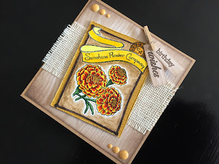Hand made birthday card with stamped marigolds on a woodgrain and a burlap hessian background