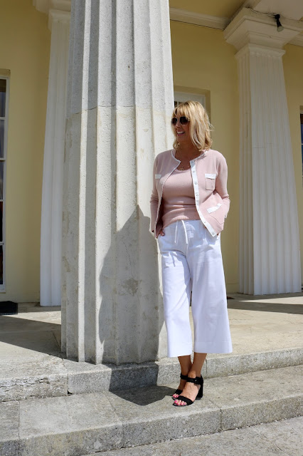 Blush pink cardi and white wide leg cropped trousers