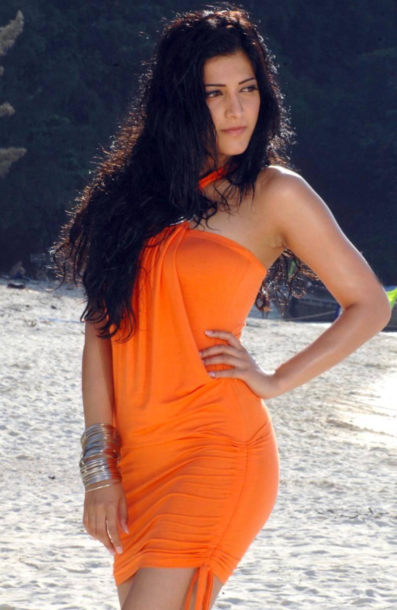Shruthi Hassan Latest Photos In Orange Dress