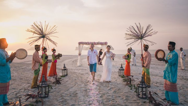 beach wedding langkawi four seasons malaysia kompang traditional music