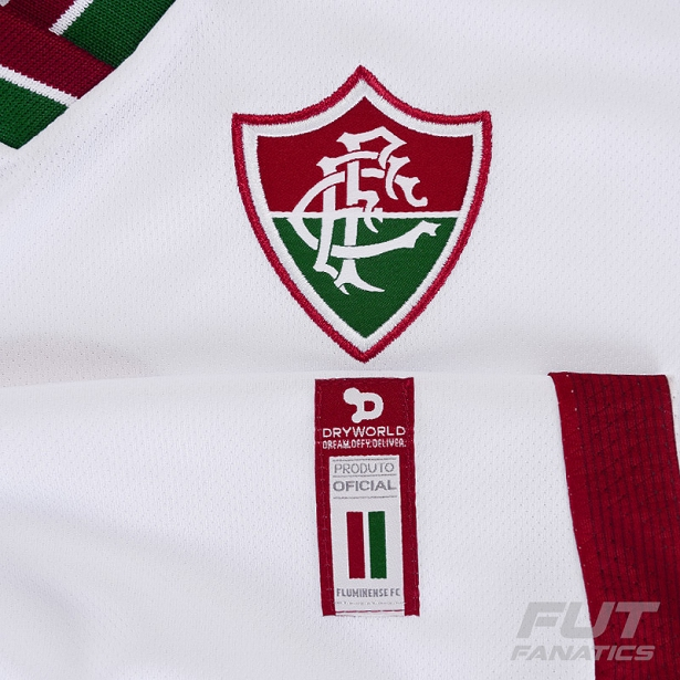 2276e6bb52 O modelo reserva é predominantemente branco com detalhes em verde e grená  na gola e nas laterais da camisa. Compre camisas do Fluminense ...