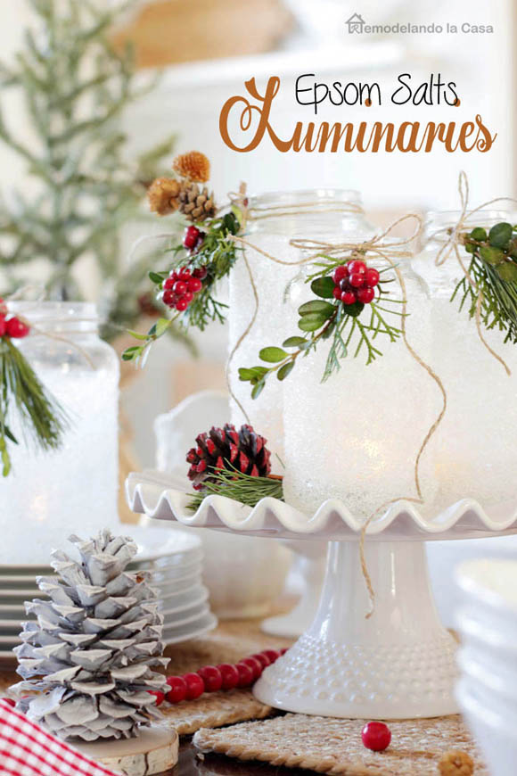 Winter or Christmas tablescape with Mason jar Epsom salts luminaries on white cake stand with garden trimmings.