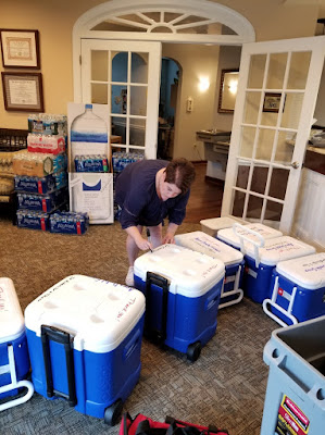 Cindy in the Apex Dental Group reception area labeling coolers