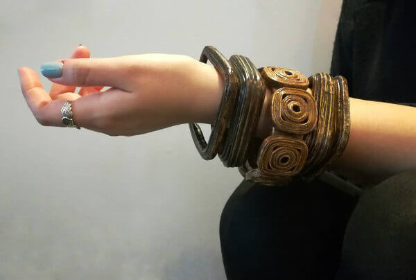 rustic stack of brown paper bracelets on wrist