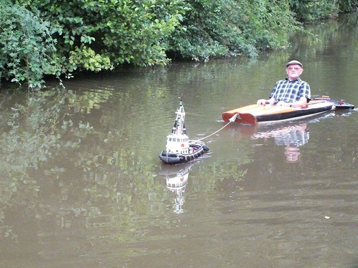 Just When You Thought You'd Seen Everything: Man Uses Tiny Tugboat to Cruise River
