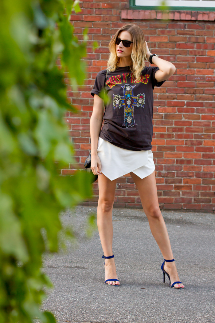 Vancouver Fashion Blogger, Alison Hutchinson, wearing Guns N Roses tee from Urban Outfitters, Zara white skort, H&M black bag and sunglasses, Guess blue ankle strap heels