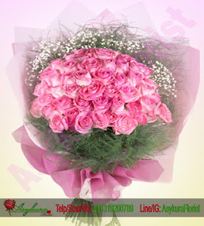 mawar merah bunga tangan