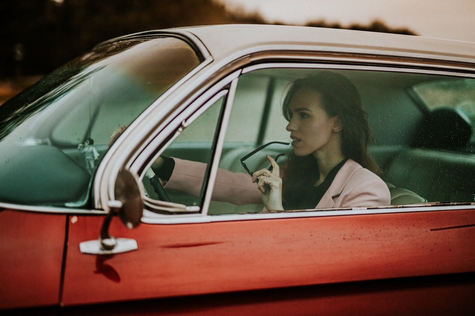 girl driving vintage car cadillac