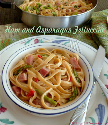 Ham and Asparagus Fettuccine are thick chunks of ham and asparagus with fettuccine in a creamy, peppery cream sauce. | Recipe developed by www.BakingInATornado.com | #cook #dinner