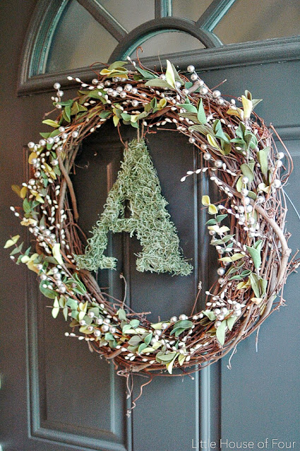 How to make a fall wreath with an initial letter and moss.