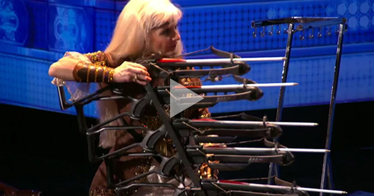 Lady Archer can hit targets using 5 different crossbows all at the same time