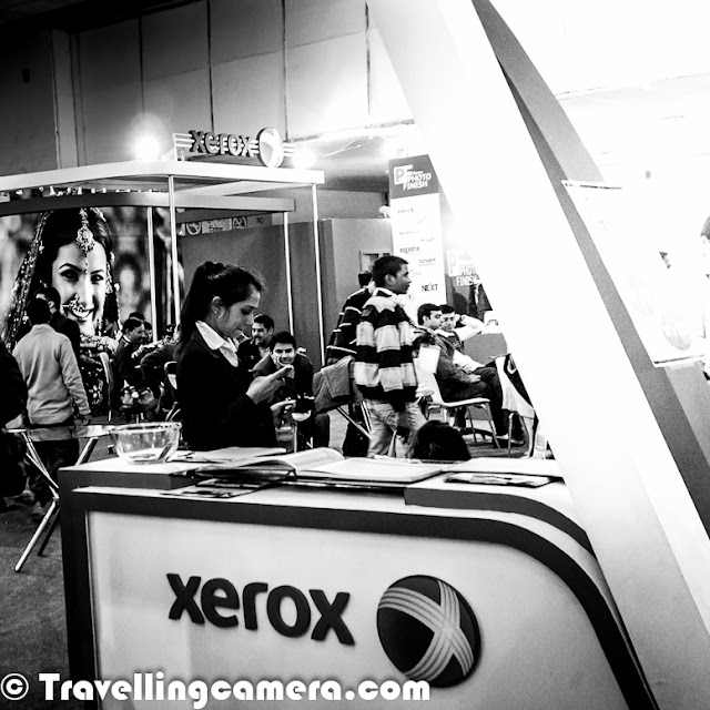 6th Jan 2013 was last day of Consumer Electronic Imaging Fair, which is popularly known as annual Photo Fair. It's a platform for Photography related businesses to showcase their products, technologies and innovations to Photographer community. This time Nikon and Canon were missing from this fair which was quite odd and overall excitement was also lesser. Let's check out this Photo Journey to know what else was there at Photo FairThis was the best part of Delhi Photo Fair 2013 ! Almost every branding poster had some very good messages writen, with significant real estate allocation to it. Messages like 'RESPECT WOMEN' and 'SAVE GIRL' etc. Big Thanks for Consumer Electronic Imaging Fair Organizers !!!In absence of Nikon and Canon, Sony was one of the biggest stall owner in Photo Fair. All registration counters had SONY branding and there was elaborated setup at Sony corner. There was a dedicated platform with some models and their mirriless cameras are feathered to screens around it. It was great to see a huge corner occupied by Xerox, the company which has contributed a lot to evolution of printing industry. In between, Xerox was lost somewhere and now seemed like a well equipment competitor for companies in printing domain. How can I miss the company which gifted a camera to me, few months back. Fujifilm is well equipped with different ranges of DLSRs & Mirroless cameras for serious photographers. Here is a view of Tamron corner where eminent Photographers Adarsh Anand and Eesh Diwan were sharing some tips about photography with audience. There was proper lighting with a backdrop and some models, so that folks could try their hands with suggested settings etc. Tamron is doing great in India Photography market and the way they are planning thing will take them to places. All the Best Tamron, although I am not sure how their products/lenses work with Nikon or Canon cameras, as I never used them. There were many other camera equipment, software, photo book and template companies who had experts at their stalls to answer Photographer's queries. It was amazing to interesting softwares created to solve some of the basic problems of Indian Photographers and wondering if these photographers will still go for branded softwares, when they get customized softwares. At the same time, how these companies are handling piracy problem in India. For next few weeks, I will be looking at some of the these softwares by Indian companies and how effective they are for non-studio photographers. Here is another big industry in Photography eco-system of India.  Album templates, Video templates for creating wedding albums or DVDs. There were plenty of companies to sell such stuff, along with some hardware for printing, binding and allDuring the visit, I was talking one of the Photographer and both of us felt that rates offered for camera equipments were comparatively high at the Fair. So folks in Delhi can get this stuff anytime at better rates in Chandani-Chowk.For some companies, it's just a platform to build their brand as many photographers from different parts of the country to Photo Fair. 'Organized biannually in Delhi by the All India Photographic Trade & Industry Association, Consumer Electronic Imaging Fair is the 3rd largest photography expo in the world and will feature not only the leading camera and lens manufacturers, but also multitude of small and home grown companies and shops, offering a glimpse and discounted pricing on their photographic and lab equipment and software. Making Consumer Electronic Imaging Fair a must visit for every photographer.We missed you Nikon and Canon !!!