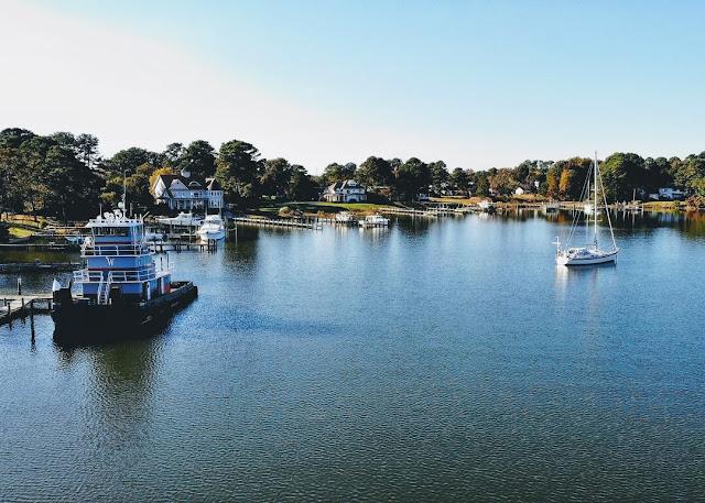 Jackson Creek, Deltaville, tug, Borealis, Hallberg-Rassy 37 anchored