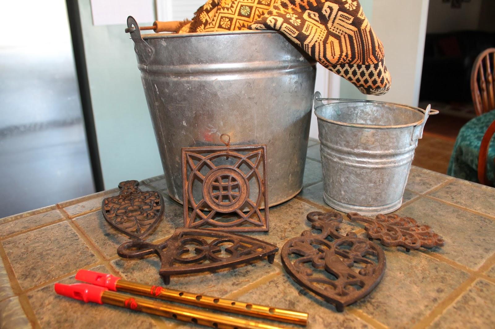 cast iron trivets, galvanized bucket, penny whistle