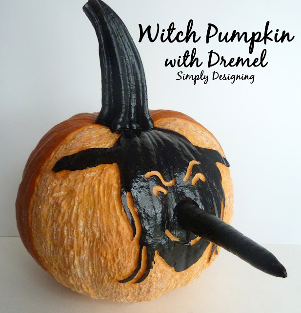 Carve a Pumpkin Witch using a Dremel and Paint from Simply Designing #pumpkins #pumpkincarving #halloween #carvingpumpkins