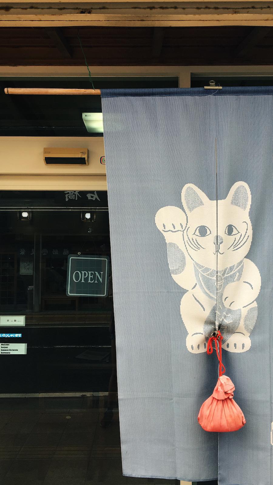Cat flag at exterior of traditional restaurant in Koyasan Japan