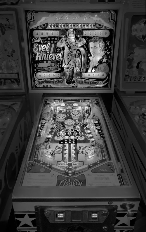 08-Evel-Knievel-Michael-Massaia-Black-and-White-Photographs-Funfair-and-Pinball-Machine-www-designstack-co