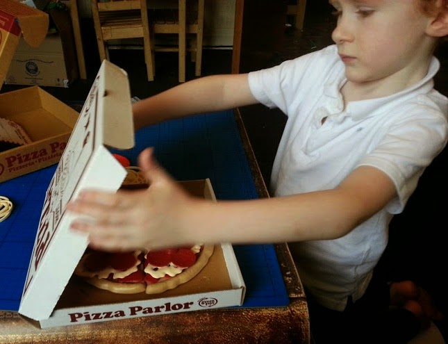 Green Toys 100% recycled plastic toy Pizza Parlour Review boy with pizza
