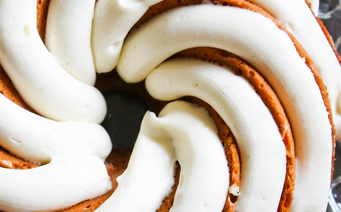 Cinnamon Roll Bundt Cake with a thick, vanilla bean-cream cheese frosting.