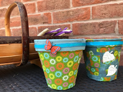 Fabric covered flower pots in the garden