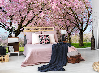 gorgeous bedroom with wall mural of pink flowers in background