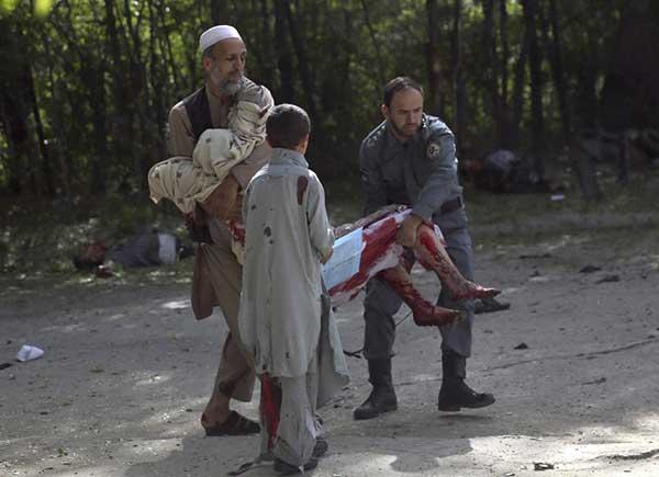 fotos niños y periodistas muertos  triple atentado Kabul, Afganistán,