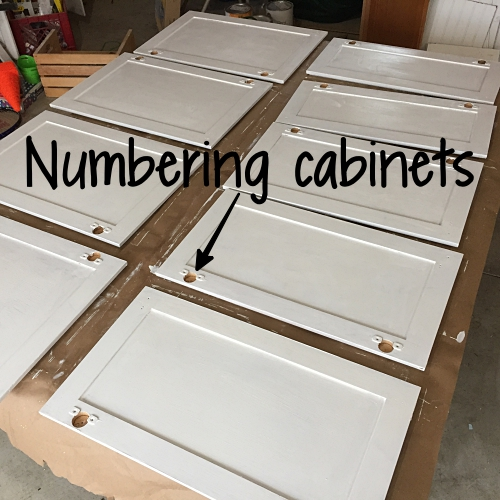 numbered and primed cabinet doors