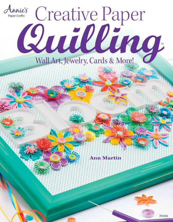 Creative Paper Quilling how-to quill papercraft book cover with quilled flowers surrounding the paper word Bloom