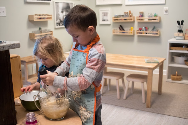 Are play kitchens Montessori? What is the role of a play kitchen in a Montessori home? Some thoughts on pretend play and practical work.