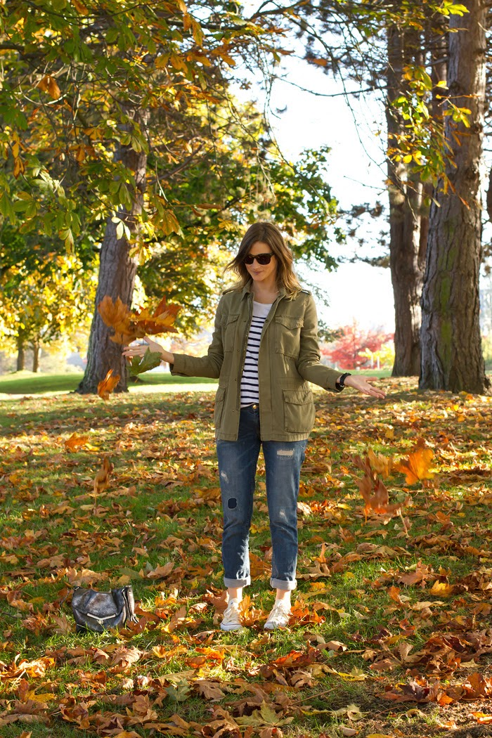 Vancouver Fashion Blogger, Alison Hutchinson is wearing an urban outfitters military coat, an aritzia striped top, zara boyfriend jeans, converse sneakers and a botkier valentina bag