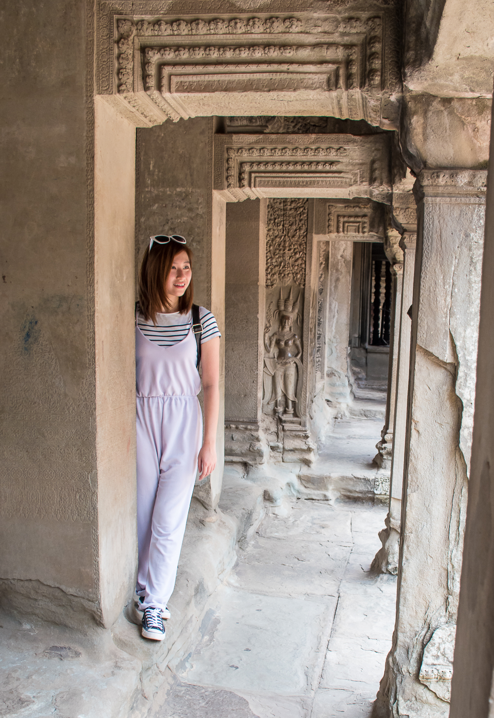 ootd and the carvings on the angkor wat temple siem reap cambodia  and its details