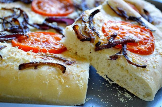 slice of tomato and caramelised onion focaccia
