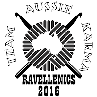 "A black and white logo of a stylised ball of yarn in the centre with a white silhouette of a map of Australia in the centre. Two crochet hooks cross the ball of yarn instead of knitting needles. Around the sides and top are the words ""Team Aussie Karma"" in outlined text. Underneath the ball of yarn are the words ""Ravellenics 2016"" in bold black text."