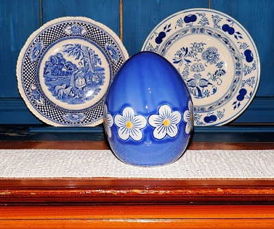 Blue and White Dinner Plates on Display with a Blue-and-White Easter Egg