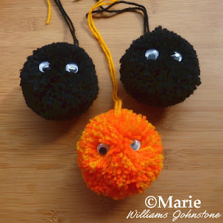 Black and orange yarn colors with wiggle eyes