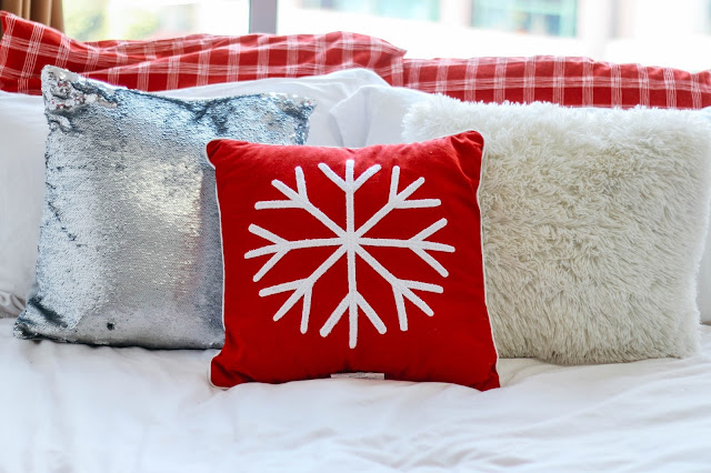 Fashion and Travel Blogger GlobalFashionGal (Brianna Degaston) decorates her Singapore apartment with cute Christmas pillows.
