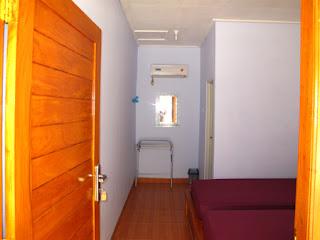kamar hotel asri karimunjawa