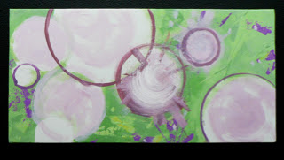 Pink circles on green background