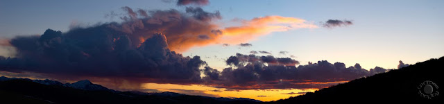 Cramer Imaging's fine art landscape panorama photograph of a sunset with clouds in the mountains in Idaho