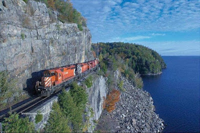 Train travelling on side of mountain