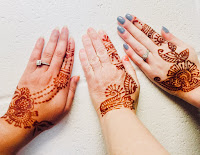 3 Hands Adorned with Henna