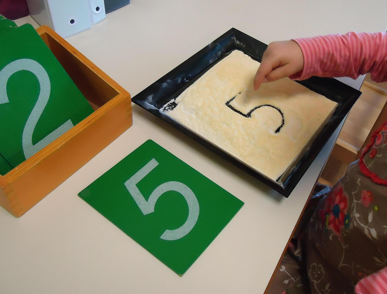 Sandpaper Numerals and Cornmeal Tray (Photo from To the Lesson!)