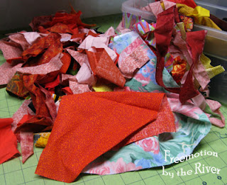 Orange fabric scraps for the Rainbow Scrap Challenge