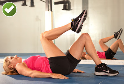 Woman Doing Knee to Chest Exercise