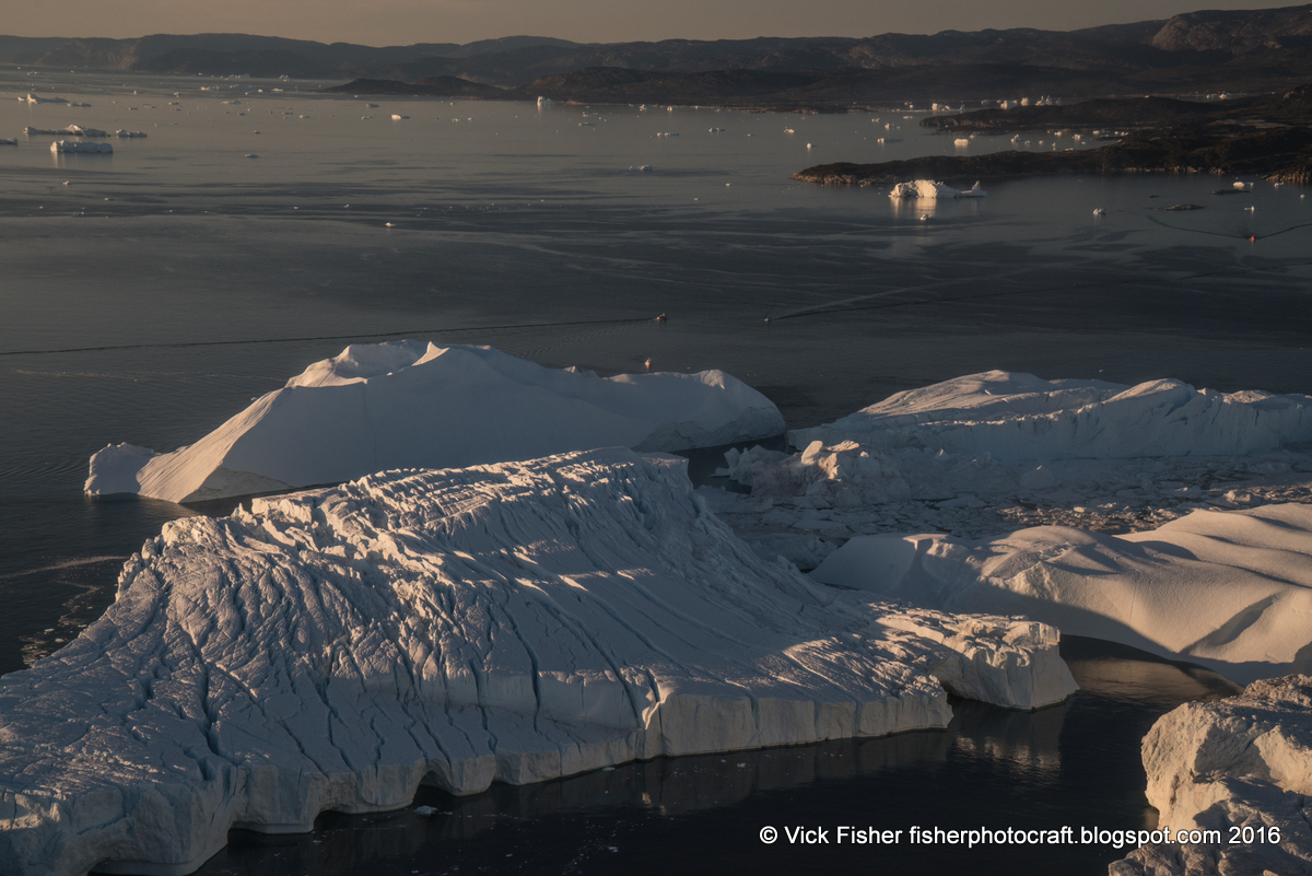 Greenland Icefjord iceberg Ilulissat glacier glaciated Denmark aerial adventure climate vacation travel tourism global arctic destination beautiful spectacular pristine nature wilderness