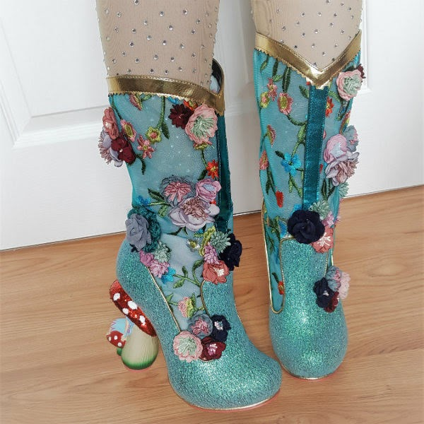 glitter boots being worn from above showing top of boot against leg