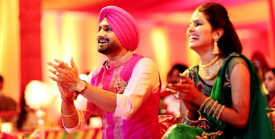 Harbhajan-Singh-with-wife-Geeta-Basra-in-sangeet