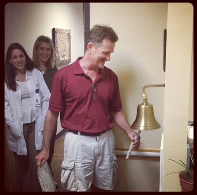 22 Stirring Pictures That Made Even The Toughest Of Us Cry - This man is ringing the bell to signify the end of his battle with cancer.